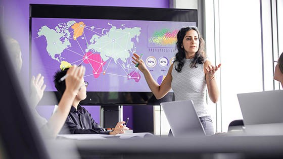 Woman presenting on large screen