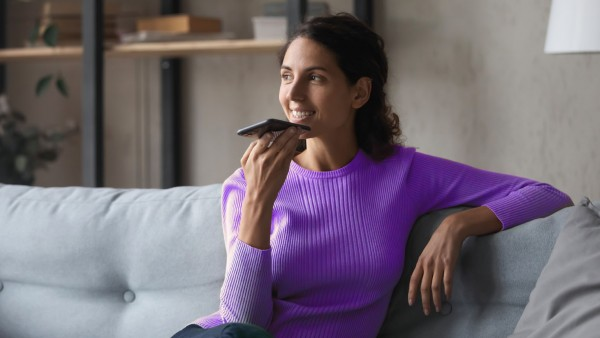 Woman on sofa talking on phone